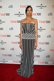 Padma Lakshmi chose this black-and-gray vertical stripe strapless dress for her cool and contemporary look at the Time 100 Gala.