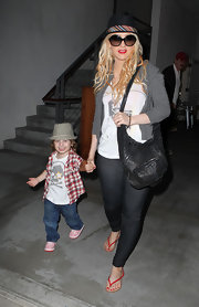 Christina showed off her leather shoulder bag while out with her son Max.