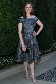 Emily Deschanel put a glam finish to her look with a pair of silver evening sandals.
