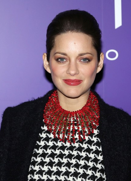 Marion Cotillard wowed in a beaded red statement necklace by Dior at a 2013 Pre-Bafta party in London.