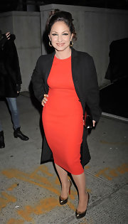 Gloria Estefan embraced the power of minimalism in a sleek red shift and a crisp black wool coat.