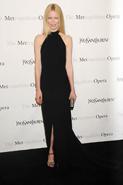 Claudia Schiffer accented her dramatic black gown with a silver hard case clutch.