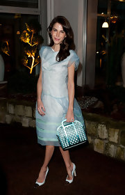 Caroline Sieber modernized her sheer taffeta confection with a metallic blue purse.