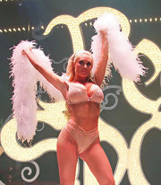 Coco showed plenty of skin during her 'Peepshow' performance in glittery nude lingerie.