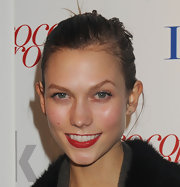 Karlie Kloss wore rich red lipstick with a hint of shine at the premiere of 'Letters to Haiti.'
