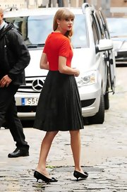 Taylor Swift looked super cute in her pleated skirt and black kitten heels.
