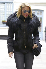 Shakira bundled up in Madrid with a unique black puffer coat lined with fur.