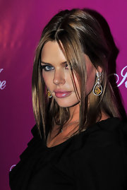 Sophie Monk paired her center part curls with gold dangle earrings.