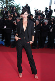 Delphine Chaneac confidently posed at the red carpet arrivals of 'This Must Be The Place' wearing a pair of black slacks, a vest, and blazer.
