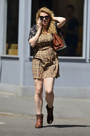 Courtney Love kept her boho look casual and low-key with this printed day dress.