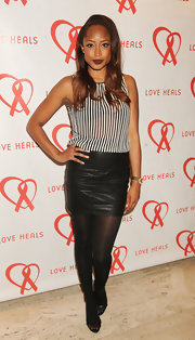 Keenyah Hill kept her look slightly edgy with this black leather mini skirt.