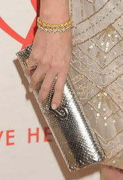 Sonja Morgan broke up her all-gold look with this silver clutch.