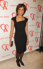 Sade Baderinwa looked classic and sophisticated in a little black dress with asymmetrical neckline.