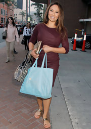 Tia Carrere paired flat gold sandals with a maroon dress when she had her nails done in Beverly Hills.