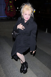 Cyndi Lauper beat the cold in black leather platform ankle boots.