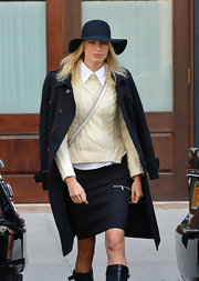 Karolina Kurkova paired a floppy hat with her preppy look for just a touch of hippie flare.