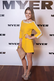 Natalie Bassingthwaighte donned a bright yellow dress with a beaded neck and sleeves at the Royal Exhibition.