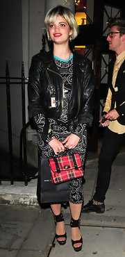 Pixie Geldof showed off her corky style while doing some shopping in London. She paired her printed dress with a plaid mini tote.