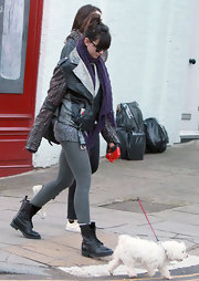 Daisy Lowe toughened her dog walking look with heavy duty boots and a studded leather jacket.