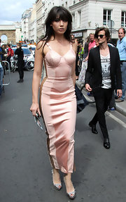 Daisy looked fierce for the Jean-Paul Gaultier fashion show in a blush corset dress ans spiked Louboutins.