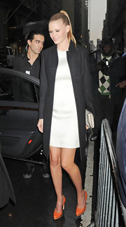 Lara Stone embraced minimalism at the Calvin Klein show in a white sheath and sleek black coat.