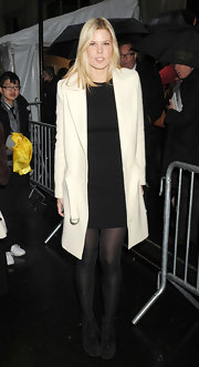 Mary Alice Stephenson contrasted a classic LBD with a minimalist white coat with sleek lines.
