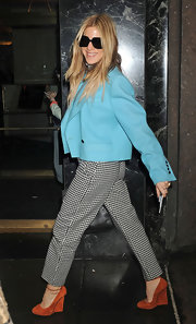 Dani Stahl kept her checkered trousers on trend with the addition of a bright turquoise jacket.