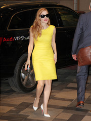 Jessica Chastain was seen at the Trump Hotel in Toronto wearing a bright yellow sheath dress.