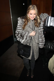 Holly Valance decked herself out in fur, matching a furry coat with a Chanel black fur purse.