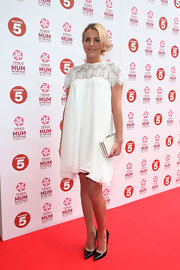 Lydia Rose Bright showed off her feminine style with a white, flowing dress with lace neckline and sleeves.