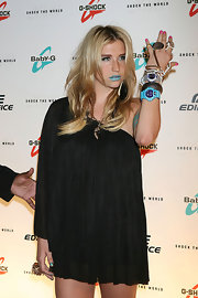 Kesha stacked her colorful digital watches and even sported matching lipstick!