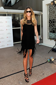 Elle MacPherson sizzled in towering black suede crisscrossing Balota booties.