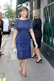 Dannii Minogue headed out in London wearing a ladylike dotted blue dress.