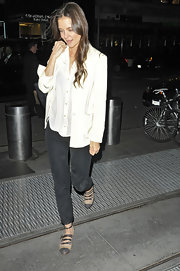 Katie Holmes opted for a low-key look in a silky white button down blouse and black skinny jeans.