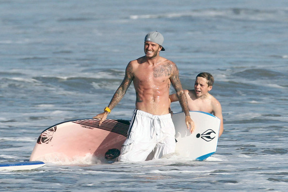 David Beckham hit the beach with his sons while wearing white draw-string swim trunks.