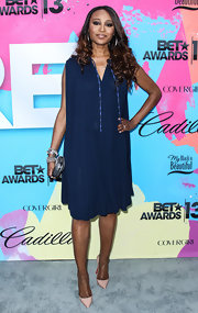 Cynthia Bailey chose a free-flowing pleated dress in a rich navy blue for her look at the Pre-BET Awards Celebration Dinner.