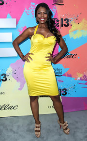 Omarosa showed off her love of bold colors with this canary yellow bustier halter dress.