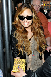 Demi Lovato arrived at SiriusXM Radio wearing her ultra-long hair in lots of sleek waves.