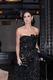 Demi Moore accentuated her dramatic black Met Gala attire with a matching satin Space clutch.