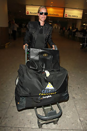 Denise van Outen carried an oversized satchel to Heathrow Airport.