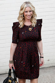 Denise van Outen posed for a photo outside iTV Studios wearing pretty accessories featuring a chain and bead cuff bracelet.