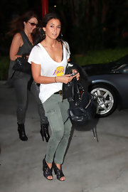 Emmanuelle Chriqui teamed her olive cargo pants with studded black leather cutout boots.