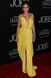 Korrina looked like a Greek goddess in this mustard yellow draped dress with silver floral epaulets on the shoulders.