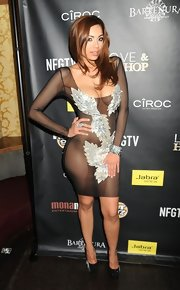 Erica Mena took the sheer mesh trend to a whole new level in this barely-there appliqued number.