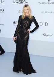 Natasha left little to the imagination at the amfAR Gala in this black beaded sheer mesh gown.