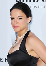 Michelle Rodriguez kept it classic with this neat bun when she attended the amfAR Gala.