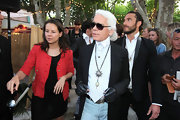 Karl arrived at the Chanel party donning a white collard shirt and tie with a silver pendant.