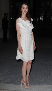 Astrid Berges Frisbey stood tall at the Chanel Couture show in fawn suede peep-toes with towering heels.