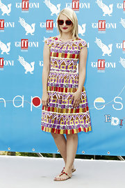 Spotted in Italy at the 2012 Giffoni Film Festival, the Glee star looks bright, cheery and, well, downright Glee-ful in this ladylike cap-sleeve dress.
