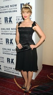 Dianna was such a doll in this black brocade dress with bowed sleeves at the Ripple of Hope Gala.